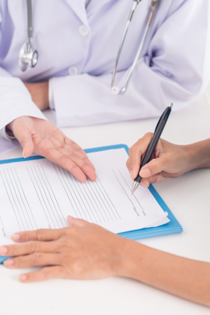 Patient signing medical contract